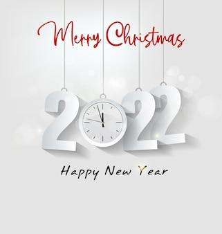 새해 복 많이 받으세요 2022 배경입니다. 검은 배경에 색종이 조각과 리본이 있는 황금빛 빛나는 숫자. 휴일 인사말 카드 디자인입니다.