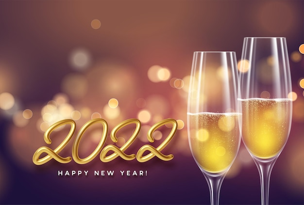 Happy new year 2022 banner with golden realistic number 2022, glasses of champagne and fireworks sparks