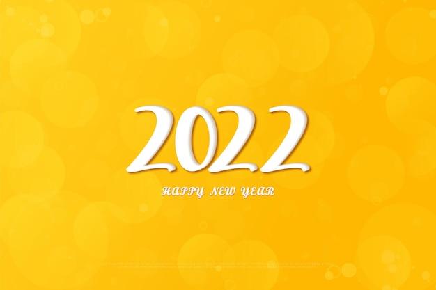 黄色の背景と白い数字の色で新年あけましておめでとうございます2022