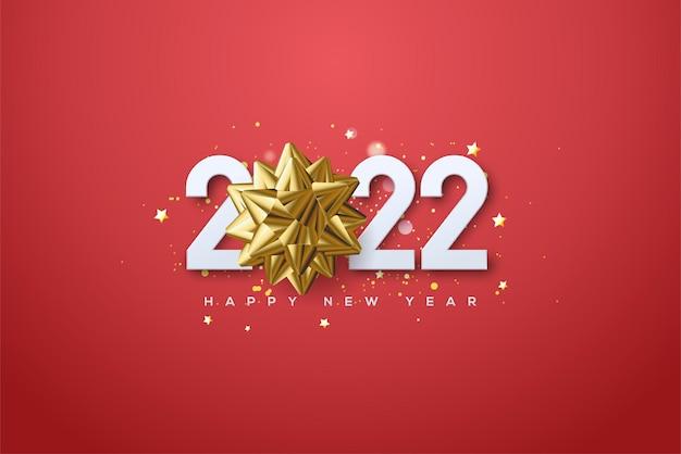 派手なゴールドの数字とリボンで新年あけましておめでとうございます2022