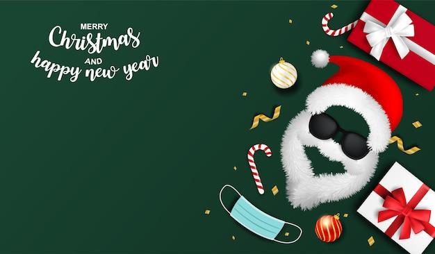 С новым годом и рождеством новая нормальная концепция. дизайн с шляпой санта-клауса и медицинской маской на зеленом фоне. вектор. иллюстрация.