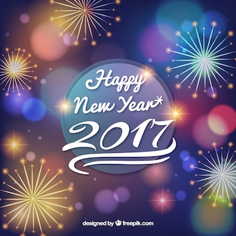 Happy new year background with fireworks Free Vector