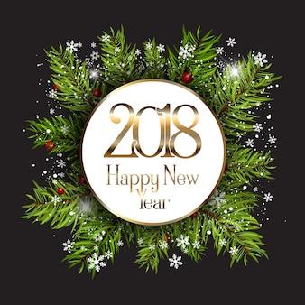 雪片とモミの木の枝で新年あけましておめでとうございます