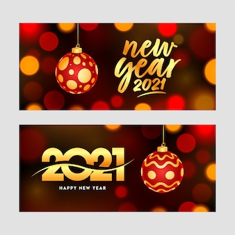 Happy new year celebration banner set with hanging bauble on brown bokeh background.