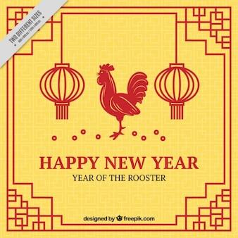 オンドリと提灯と幸せな新年中国の黄色の背景
