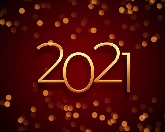 Cartolina d'auguri di felice anno nuovo con numeri d'oro 2021 e scintillii