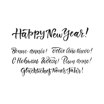 Happy new year lettering set in different languages -russian, italian, spanish, french, german, english. holidays vintage brush calligraphy for invitation, greeting card, prints.