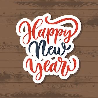 Happy new year lettering sticker on wood
