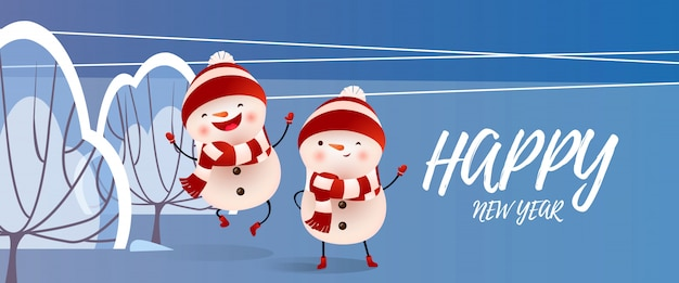 Happy new year lettering with smiling snowmen