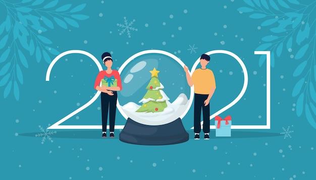 新年あけましておめでとうございます男性とギフト2021ロゴ番号を持つ女性。 2021年の新年のお祝いの招待状のタイポグラフィ。