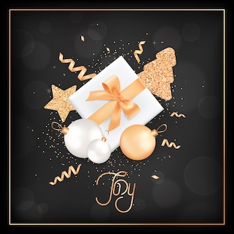 Happy new year or merry christmas elegant greeting card with gift box and festive decoration in white and gold colors with glitter on black blurred background with golden frame and joy typography