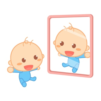 A happy newborn baby is smiling in front of a mirror.