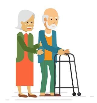 笑顔と公園で歩く幸せな古いカップル