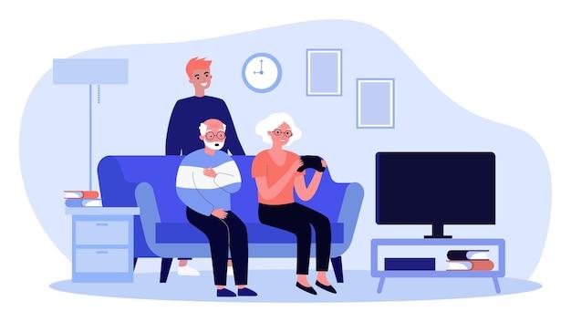 Счастливые старые люди играют в видеоигры дома