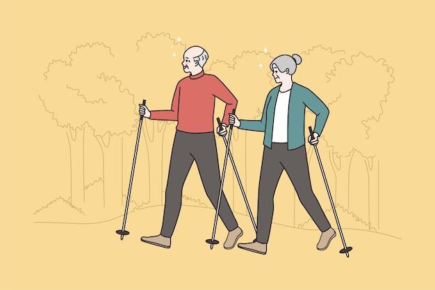 幸せな高齢者は森の中をノルディックウォーキングします