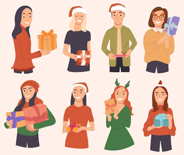 Happy people in christmas costumes are holding gifts