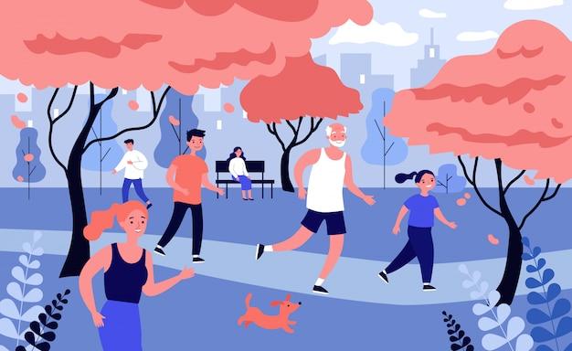 秋の都市公園で走っている幸せな人