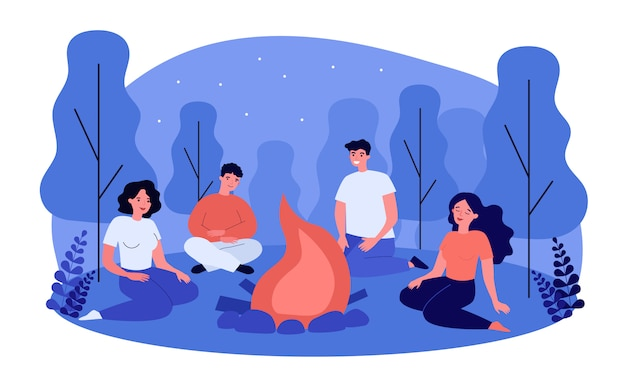 Happy people sitting at campfire at night
