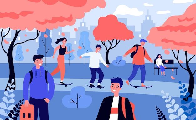 秋の公園でスケートをする幸せな人々。