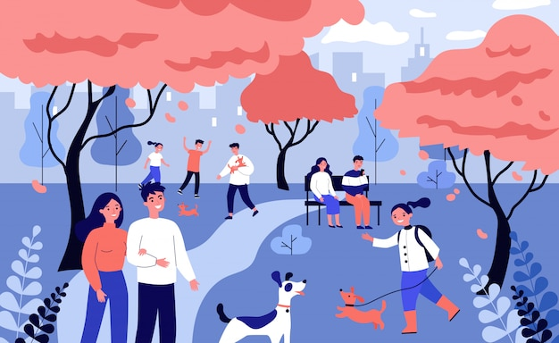 春の公園で犬を散歩して幸せな人々