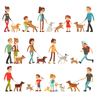Happy people with pets. women, men and children playing with dogs and puppies.