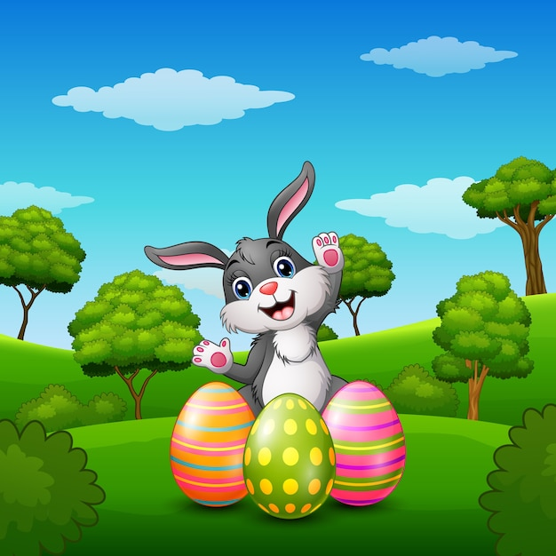 Happy rabbit cartoon with easter eggs in the park