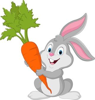 Happy rabbit holding carrot