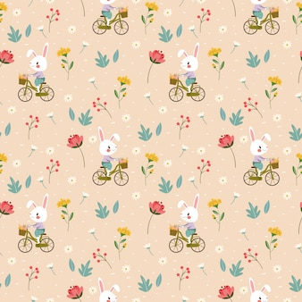 Happy rabbit is biking among variety flower seamless pattern