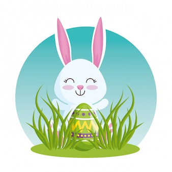 Happy rabbit with easter egg in the grass