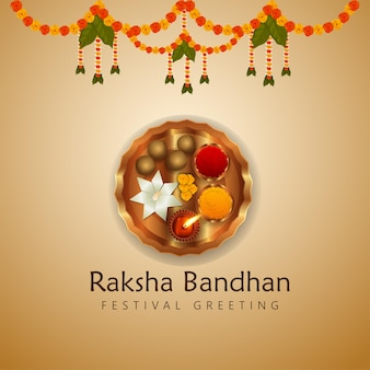Happy rakhi indian festival celebration greeting card with creative pooja thali and garland flower