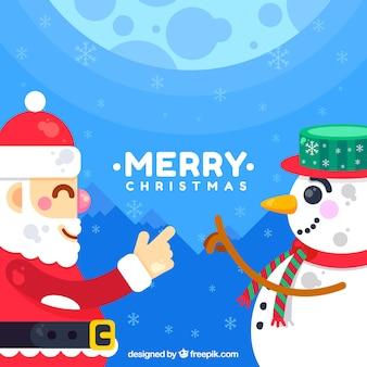 Счастливый санта-клаус и снежный человек