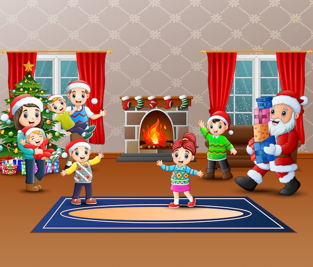 Happy santa claus holding a gifts to give a family