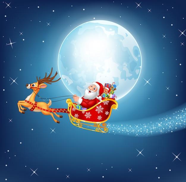 彼のクリスマスソリのハッピーサンタはトナカイに引っ張られている