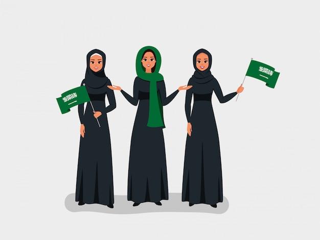 행복한 사우디 여성들은 사우디 아라비아 독립 기념일을 축하합니다.