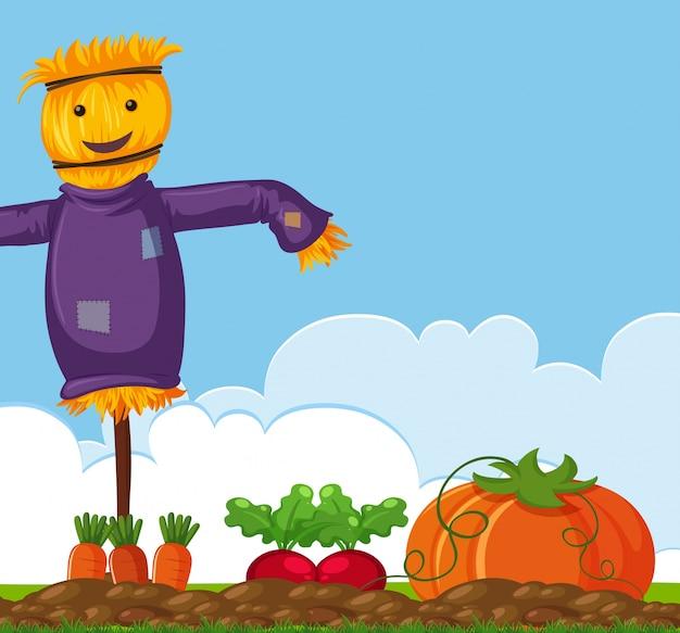 Happy scarecrow on vegetable garden