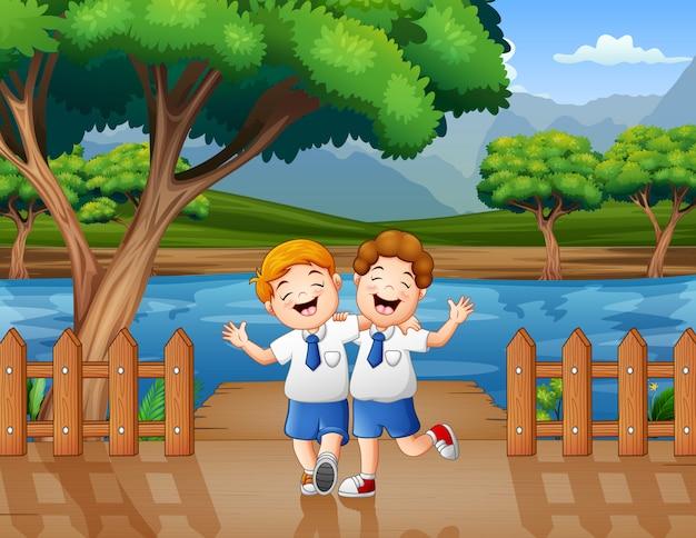 Happy school boys joking on the pier