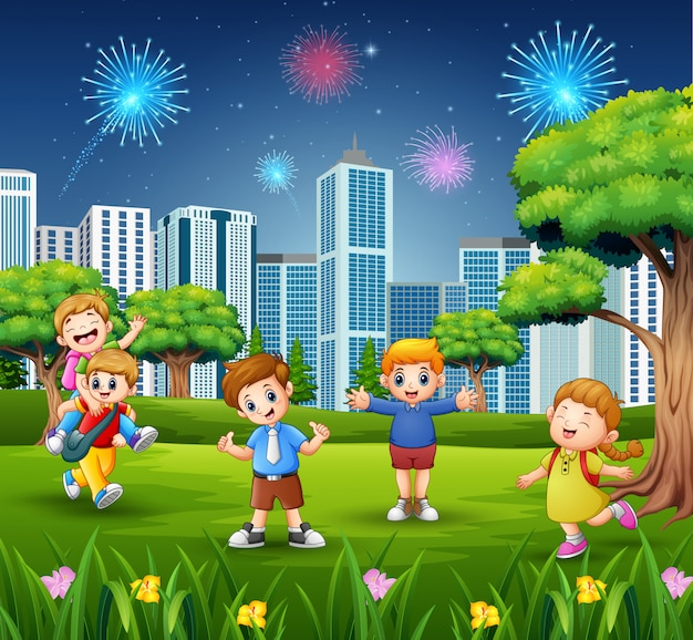 Happy school children on the city park with firework