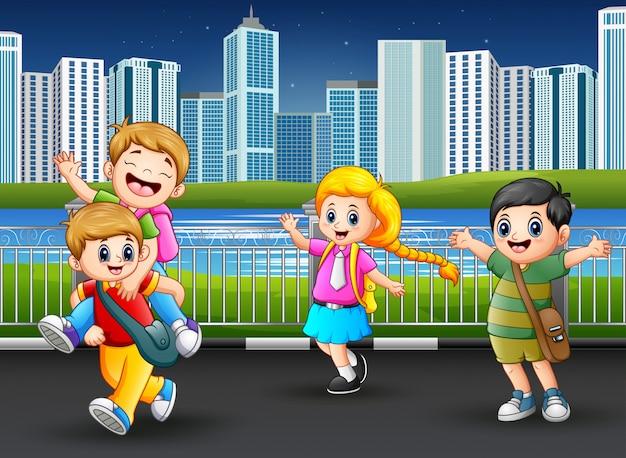 Happy school children at the city park