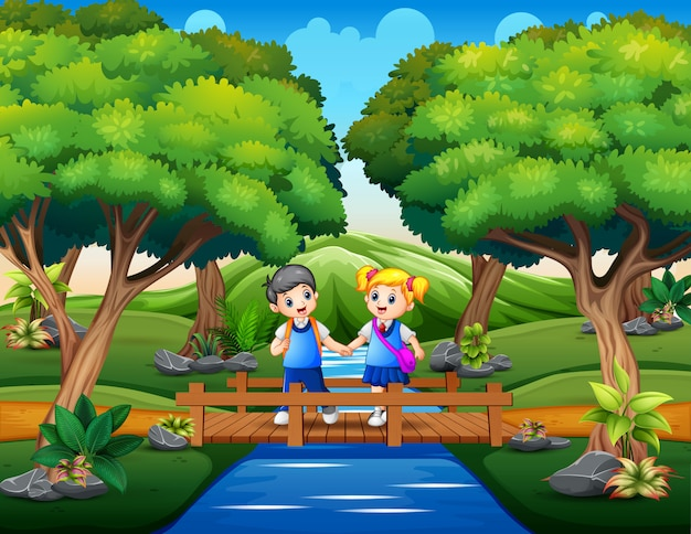 Happy school children crossing wooden bridge