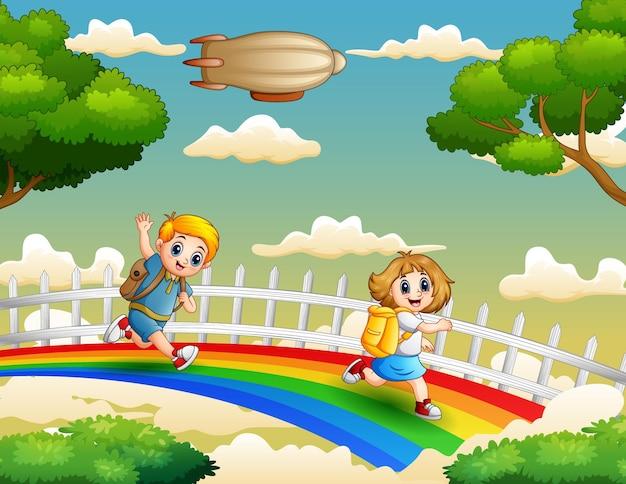 虹のイラストで学校に行く幸せな学校の子供たち
