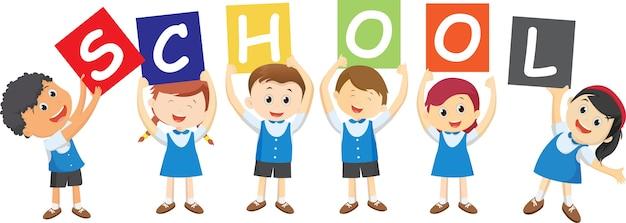 Happy school children holding board.