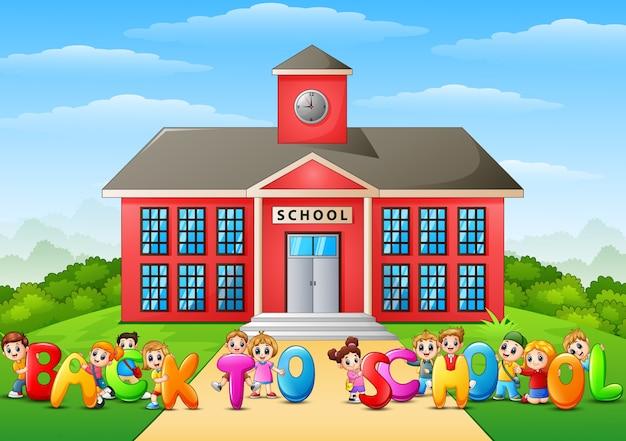 Happy school children holding the words