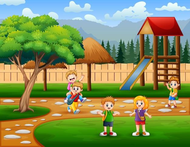遊び場のイラストで幸せな学校の子供たち