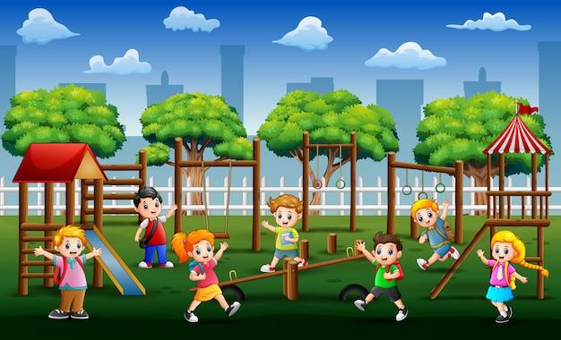 Happy school children playing in public park