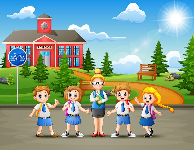 Happy school children in the road to school