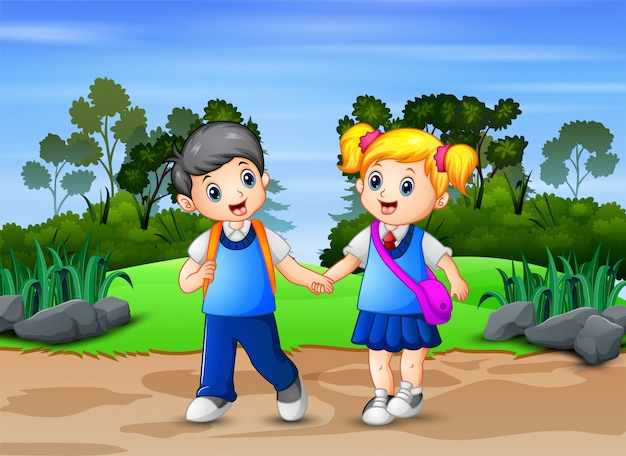 Happy school children walking pass through in park