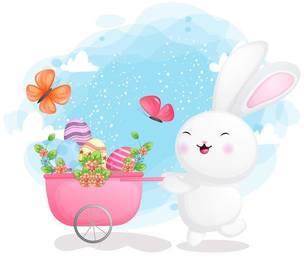 Счастливый улыбающийся кролик собирает декоративное пасхальное яйцо в тележке
