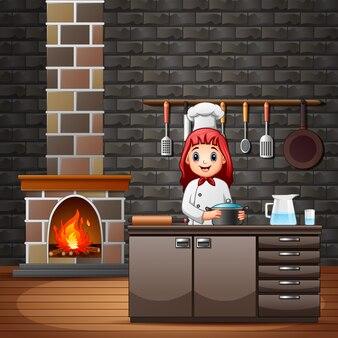Happy smiling chef in kitchen preparing meals