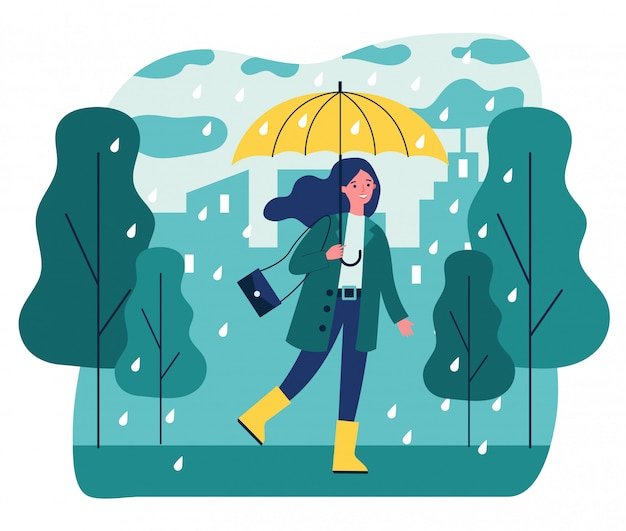 雨の日に歩いて傘で幸せな笑顔の女の子