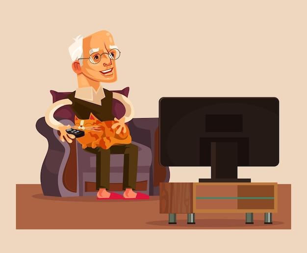 幸せな笑顔の老人おじいちゃんはテレビ番組を見る
